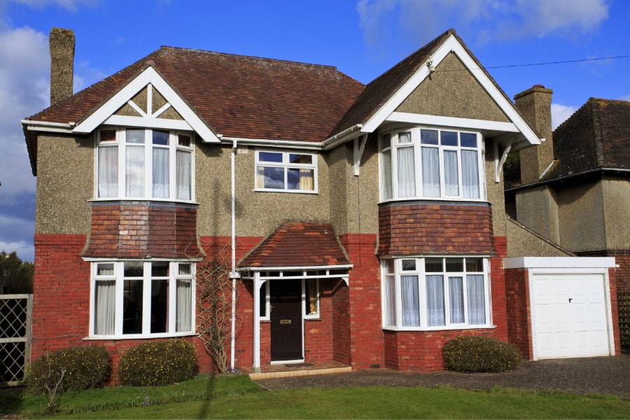 Large double fronted 4 bedroom property with bay windows and attached single garage in Swansea