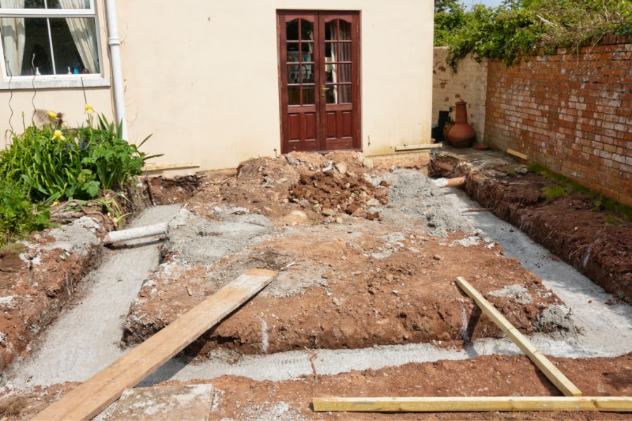 Footing for rear extension completed with concrete poured and hardened in readiness for foundations and slab